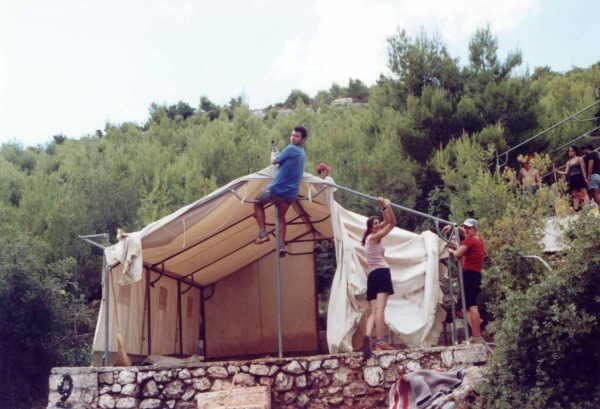 Volunteers building a tend